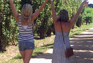 Gals having fun on an Open Range Wine Tour near Fredericksburg, TX.
